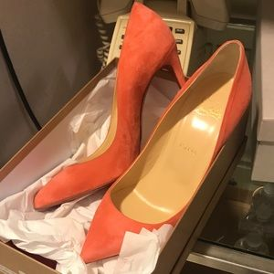 New salmon peach colored Louboutins